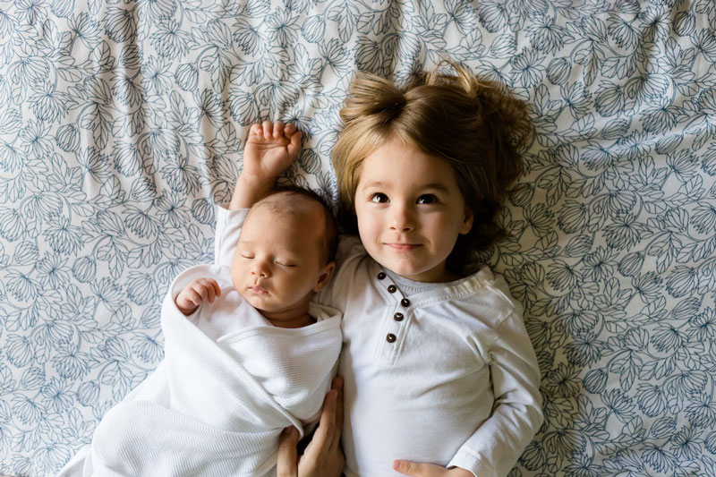 Picture of two young children in bed